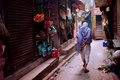 Lonely senior walk through the narrow streets of the old town with local shops Royalty Free Stock Photo