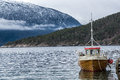Lonely small fishing boat Royalty Free Stock Photo