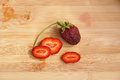 Lonely strawberry on a chopping board Royalty Free Stock Photo