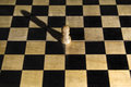 Lonely survivor pawn empty chess board Royalty Free Stock Photos