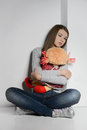 Lonely teenage girl sad teenage girl sitting on the floor and h hugging a toy Royalty Free Stock Photos