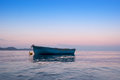Lonely traditional greek fishing boat on sea water Royalty Free Stock Photo