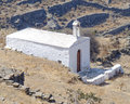 Lonely white church on mountain slopes of an aegean island greece Royalty Free Stock Photography