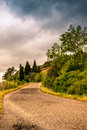A lonely winding road on the hills of Tuscany - 2 Royalty Free Stock Photo
