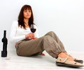 Lonely woman glass red wine sitting floor Stock Images