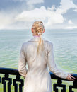 Lonely woman looking at the sea Royalty Free Stock Photo