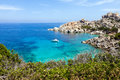 Lonely yacht in tropical beach aerial view of capo testa sardinia italy Royalty Free Stock Photography