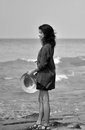 Lonely young woman walking beach black white Stock Image