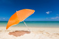Lonesome orange sunshade beautiful beach with an turquoise sea blue sky and white sand mauritius africa Royalty Free Stock Images