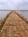 Long bamboo bridge from Kampong Royalty Free Stock Photos