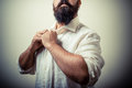 Long beard and mustache man with white shirt on gray background Stock Photos