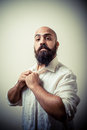 Long beard and mustache man with white shirt on gray background Royalty Free Stock Photography
