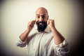 Long beard and mustache man with white shirt on gray background Royalty Free Stock Photo
