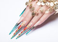 Long beautiful manicure on the fingers of turquoise and red. Nails design. Isolate object. Close-up Royalty Free Stock Photo