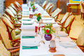 Long beautifully set table in a restaurant Stock Images
