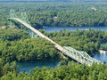 Long bridge in the middle of canadian wood photo is capturing Royalty Free Stock Image