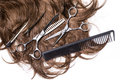 Long brown hair with scissors Royalty Free Stock Photo
