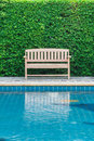 Long chair decorate swimming pool nobody leaf tree environment background Stock Photos