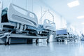 Long corridor in hospital with surgical beds tinted picture Royalty Free Stock Images