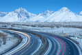 Long curved highway and view to mountains in the morning Royalty Free Stock Photo