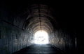 Long Dark Tunnel With Light At The End Stock Photo