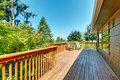 Long deck terrace with wood railings and green landscape large sunny Royalty Free Stock Photos