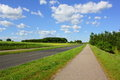 Long distance cycling with sunshine and green landscape Stock Photography
