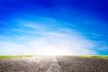 Long empty asphalt road highway towards sun travel transport concepts Stock Image