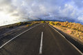 Long empty desert road on a cludy day Royalty Free Stock Images
