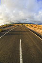 Long empty desert road on a cludy day Royalty Free Stock Photo