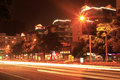 Long exposure image of cars rushing over a street in central amoy city china at night Royalty Free Stock Photo