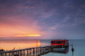 Long exposure of magic sunrise over the ocean with a hut in the Royalty Free Stock Photo