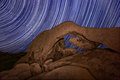 Long exposure over the rocks of joshua tree park star trail streaks Royalty Free Stock Images