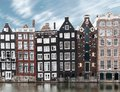 Long exposure picture of traditional Amsterdam old town architecture