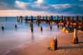 Long exposure at sunset of pier pilings in the delaware bay at s beach cape may new jersey Stock Image