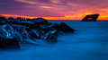Long exposure at sunset of the uss atlantis shipwreck at a jetty after beach cape may new jersey Stock Photos