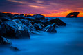 Long exposure at sunset of the uss atlantis shipwreck at a jetty after beach cape may new jersey Stock Photo