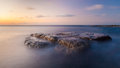 Long exposure waterscape and rock at twilight big Stock Photography