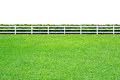 Long fence on white and green grass isolated background Stock Images