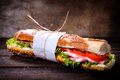 Long gourmet sandwich with prosciutto and vegetables selective focus Stock Image