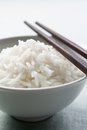 Long grain rice bowl with chopsticks Stock Image