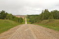 Long gravel road lined by trees Royalty Free Stock Photo
