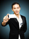 Long hair businessman showing blank card on white background Royalty Free Stock Images