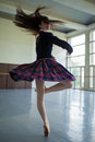 Long-haired ballerina spins in the dance moves on one leg to sta Royalty Free Stock Photo