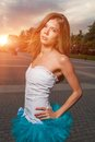 Long haired blonde outdoor weared tutu skirt fashion shot at evening costume sunset backlit Stock Photos