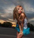 Long haired blonde outdoor weared tutu skirt square shot of the costume backlit Stock Photo