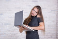 Long-haired  business lady,  or administrator with notebook and Royalty Free Stock Photo