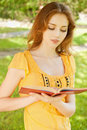 Long-haired girl reads book Stock Photo