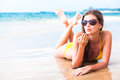 Long haired girl in sunglasses blowing a kiss on tropical beach this image has attached release Stock Photography