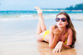 Long haired girl in sunglasses blowing a kiss on tropical beach this image has attached release Royalty Free Stock Photography